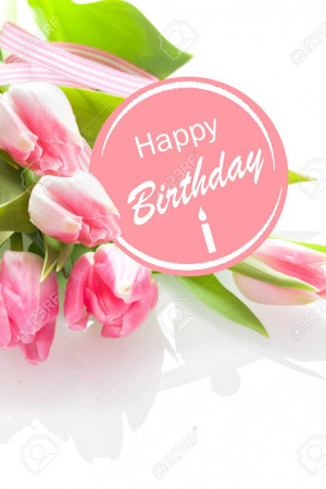 Pretty feminine Happy Birthday greeting with a festive pink rosette and a bouquet of beautiful fresh pink tulips on a white background, closeup perspective